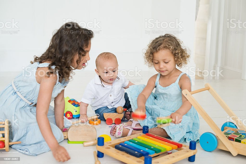 Siblings Playing With Toys At Home royalty-free stock photo