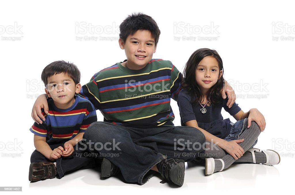Siblings Sitting royalty-free stock photo