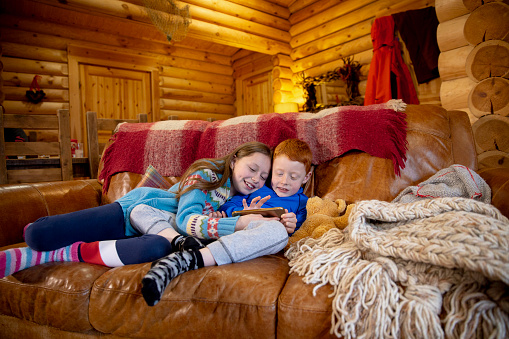 Siblings Using A Smartphone Stock Photo & More Pictures of 10-11 Years