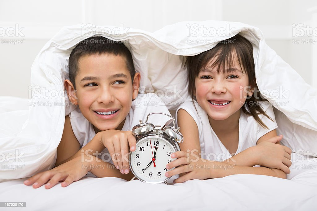 Siblings waking up in the morning royalty-free stock photo