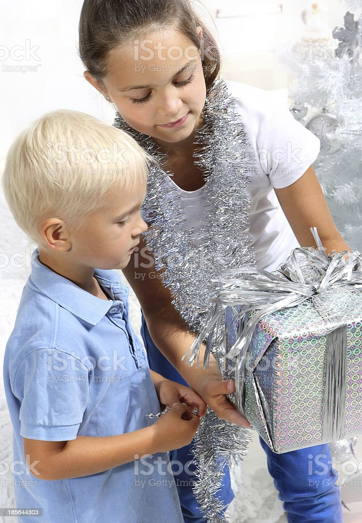 siblings with a gift royalty-free stock photo