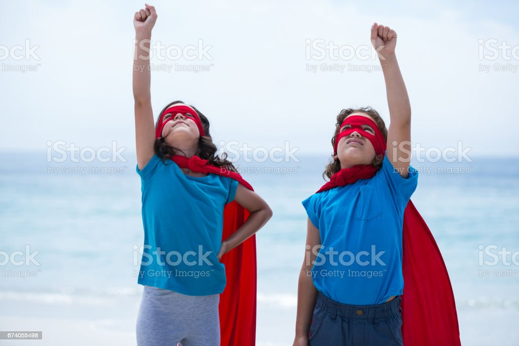 Siblings with hand raised looking up royalty-free stock photo