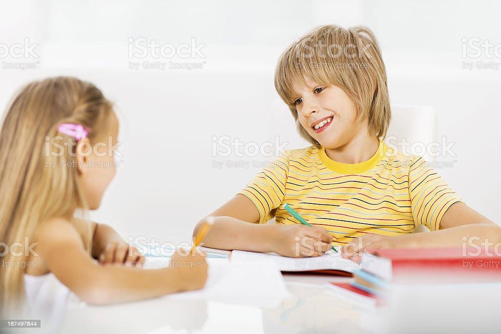Siblings writing and communicating. royalty-free stock photo