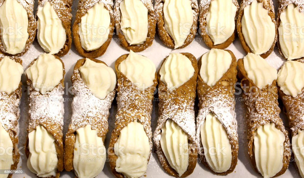 Sicilian cannoli with sweet custard for sale in bakery stock photo
