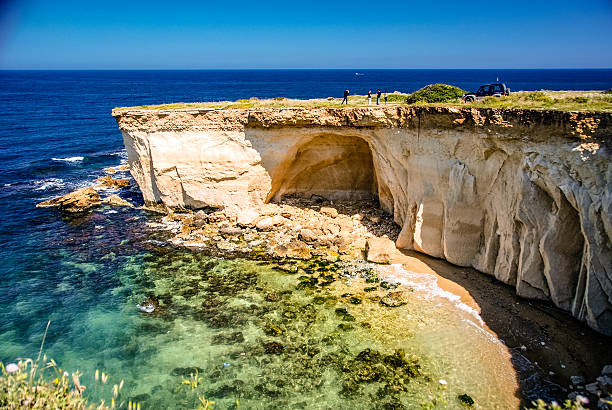 Sicilian Coastline The rugged coastline just south of Siracusa, Sicily. catania stock pictures, royalty-free photos & images