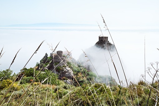 Sicily. Ionian sea cost line view from top on Santa Teresa di Riva covered by fog. Beauty in Sicily as a tourist attraction. Season on mediterranean sea. Ionian sea.