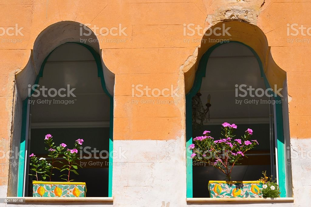 Sicilia, Italy. Fiori alle finestre stock photo