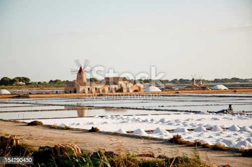 Marsala is an ancient location, in Sicily, famous for wines and its saltworks. Here a beautiful landscape with windmills and bunches of salt.