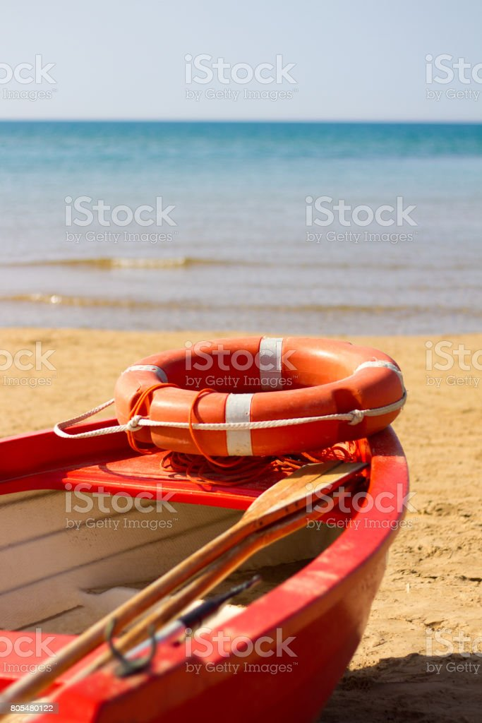 Sicily Peaceful Beach Scene: Early Morning, Orange Lifeboat stock photo