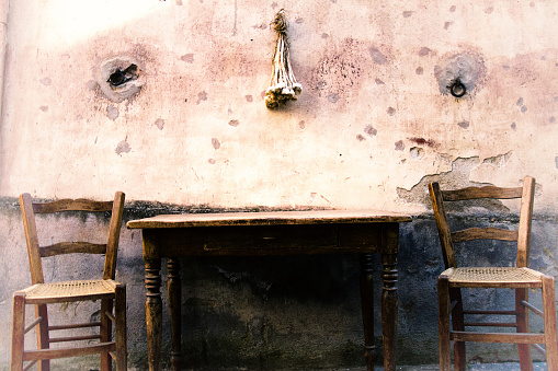 Sicily Style: Rustic Chairs and Table, Mottled Wall, Hanging Garlic