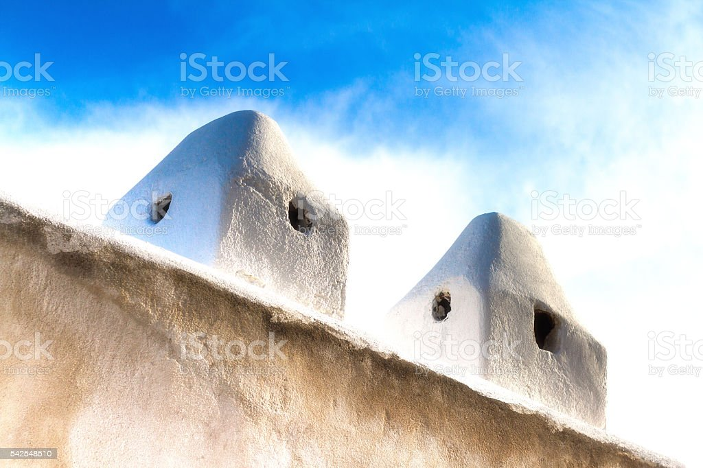 Sicily Style: White Chimneys on Whitewashed House, Aeolian Islands stock photo