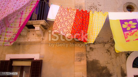 Sicily: Vibrant Laundry on Line: Pinks, Oranges, Yellows