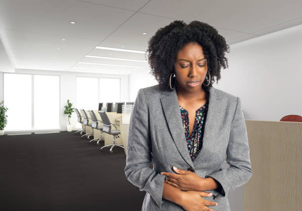 Sick African American Businesswoman in an Office stock photo