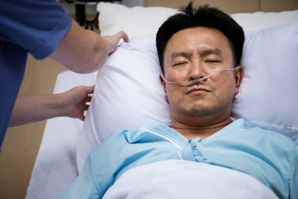 A sick Asian man in a hospital A sick Asian man in a hospital oxygen tube stock pictures, royalty-free photos & images