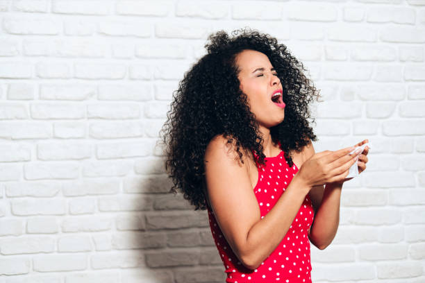 Sick Black Woman African American Girl Sneezing For Cold Allergy stock photo