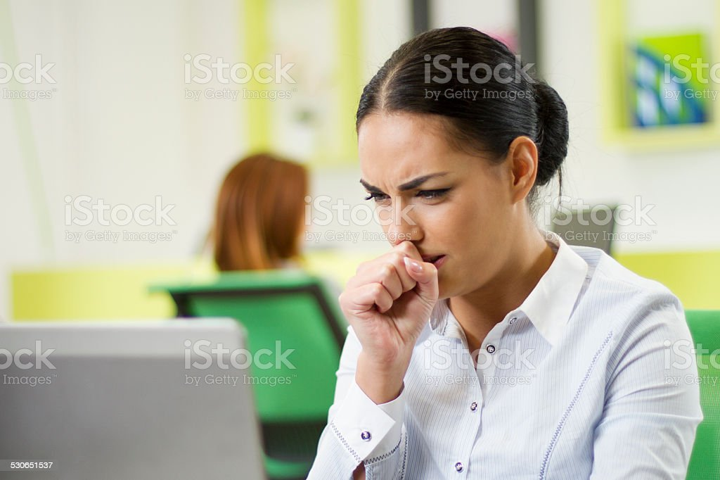 Sick businesswoman stock photo
