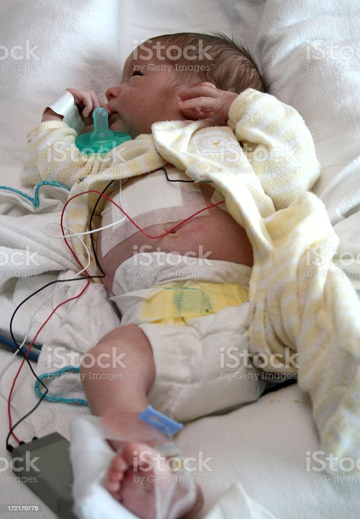 Sick Caucasian Male Newborn Baby in a Hospital royalty-free stock photo