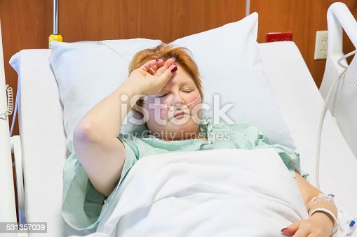 Sick Caucasian Woman Lying In Hospital Bed Stock Photo