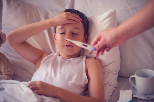 sick child girl in a bed - china drug foto e immagini stock
