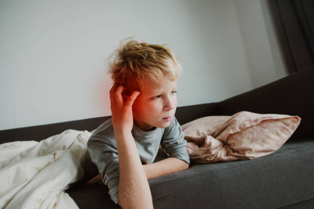 Sick child with ear pain, sharp pain concept Sick child with ear pain, sharp pain concept, virus or infection infectious disease stock pictures, royalty-free photos & images