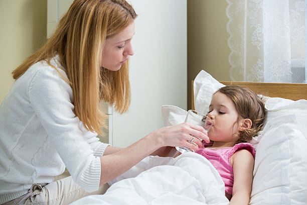 Sick child with high fever stock photo