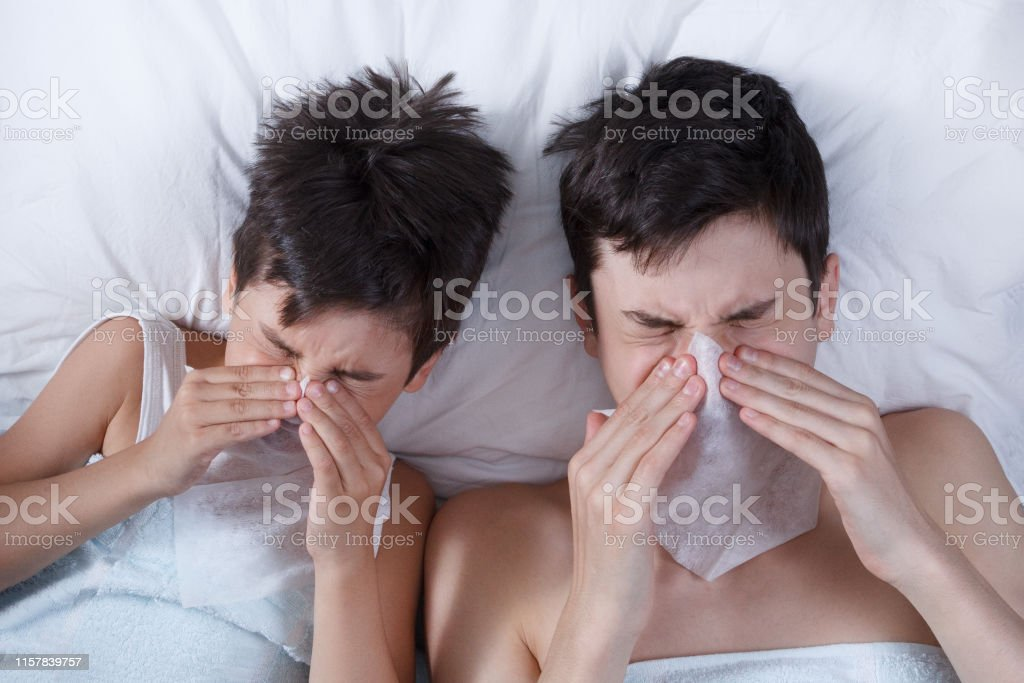 sick children in a bed, the child and the teenager, brothers got sick...