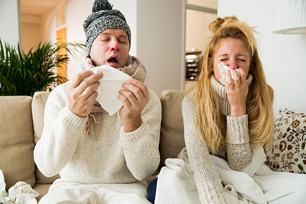 Sick couple catch cold stock photo