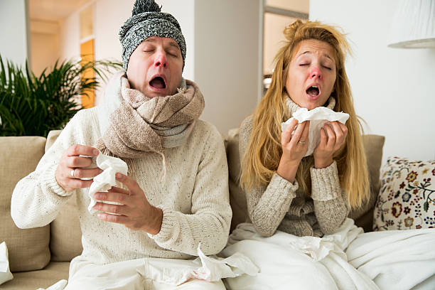 Sick couple catch cold - foto de stock