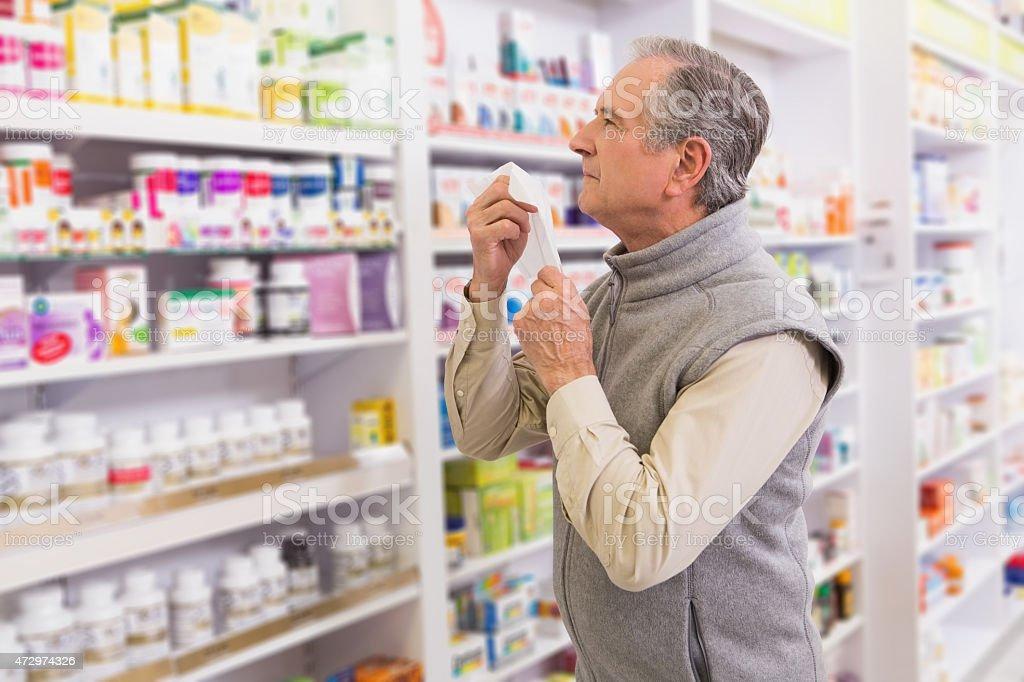 Sick customer holding a tissue stock photo