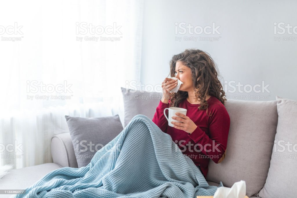 Sick desperate woman has flu. stock photo