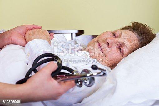 istock Sick elderly woman 810856968