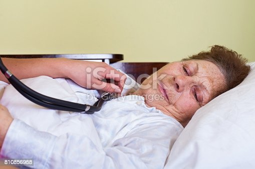 istock Sick elderly woman 810856988