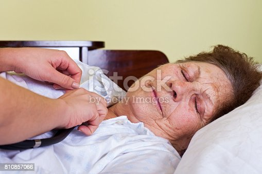 istock Sick elderly woman 810857066