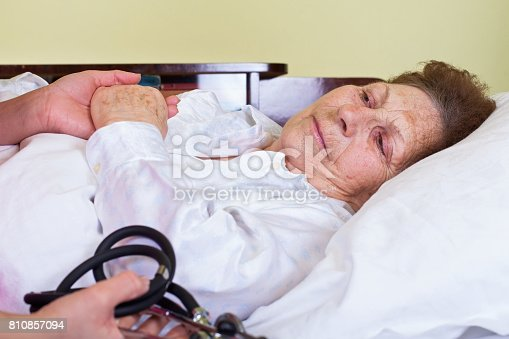 istock Sick elderly woman 810857094