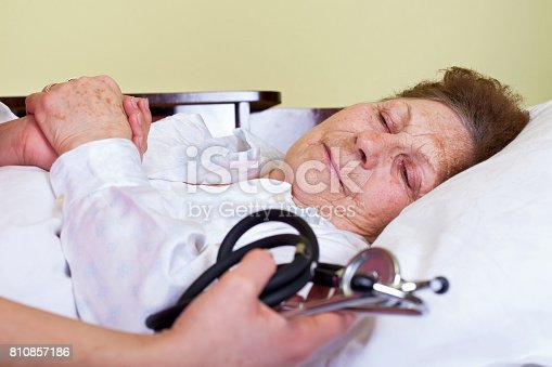 istock Sick elderly woman 810857186