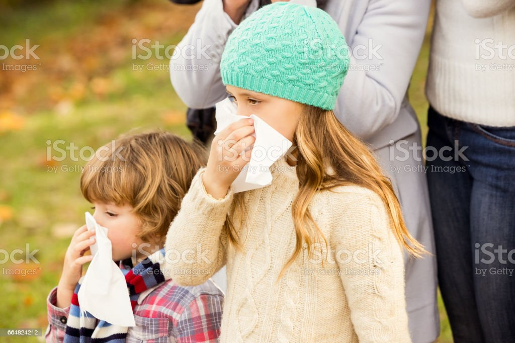 Sick family blowing their noses stock photo