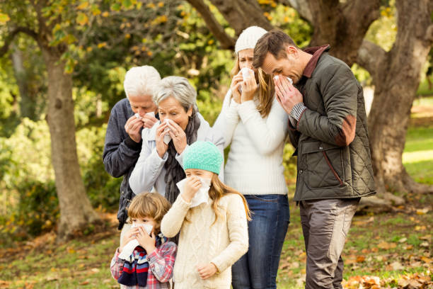Sick family blowing their noses Sick family blowing their noses on an autumns day human parainfluenza virus stock pictures, royalty-free photos & images