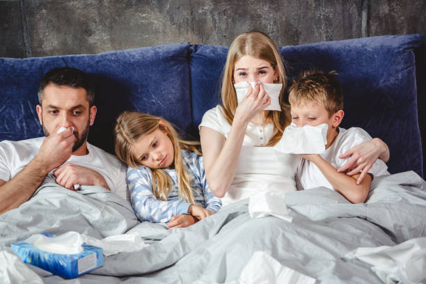 Sick family on bed stock photo