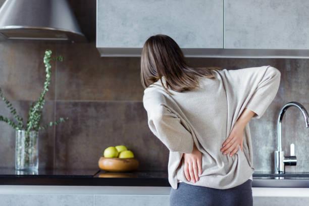 Sick female with back ache. Health care concept stock photo