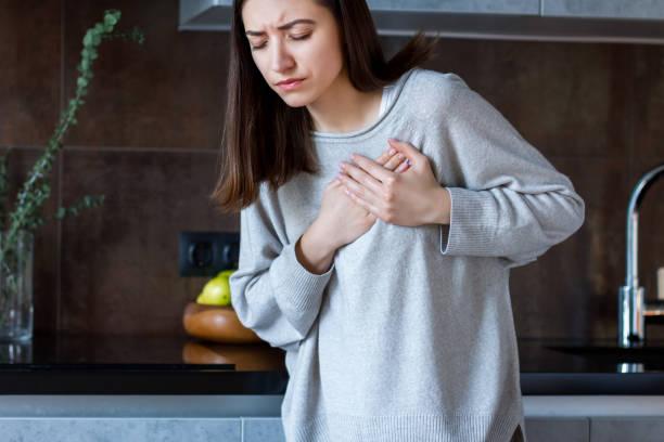 Sick female with heart attack. Health care concept stock photo