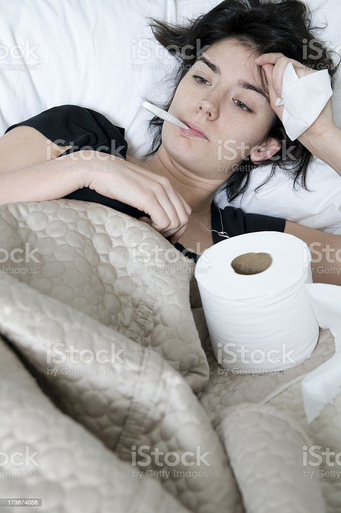 Sick girl in bed royalty-free stock photo