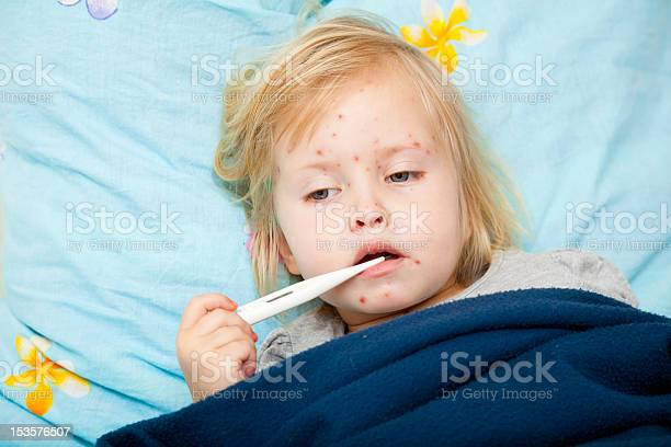 Sick Girl Is Measuring The Temperature Stock Photo - Download Image Now