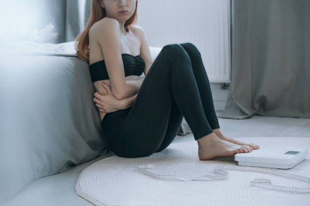 Sick girl with stomach pain stock photo