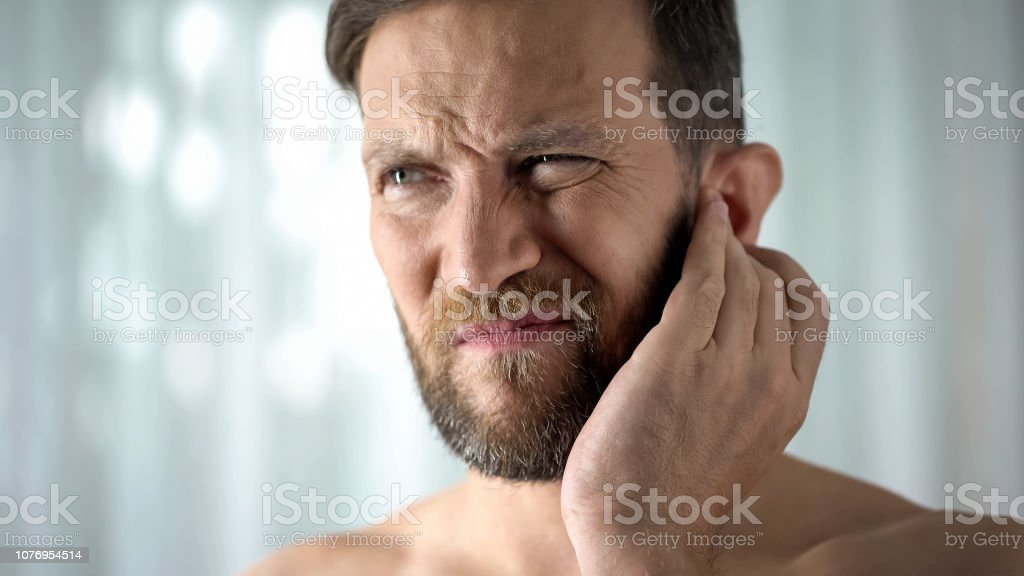 Sick guy feeling ear pain, health care, neurological infection,...