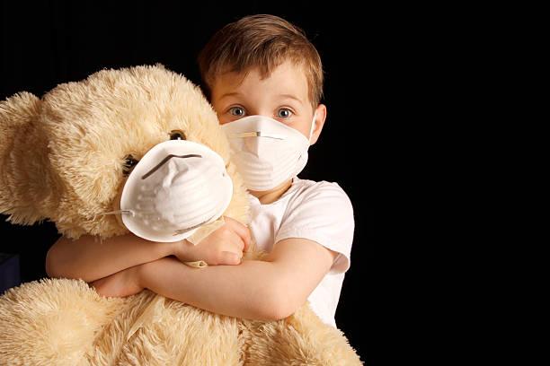 Sick Kid and Teddy bear. stock photo
