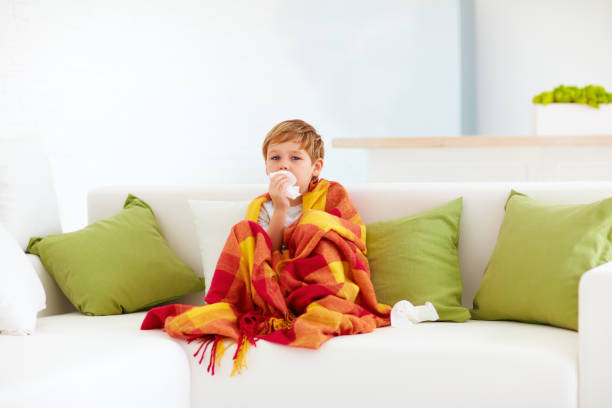 sick kid with runny nose and fever heat at home sick kid with runny nose and fever heat at home respiratory disease stock pictures, royalty-free photos & images