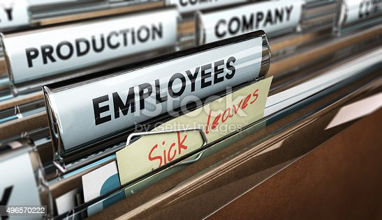 Close up on a file tab with the word employees plus a note with the text sick leaves, blur effect at the background. Concept image for illustration of sick leave entilement.