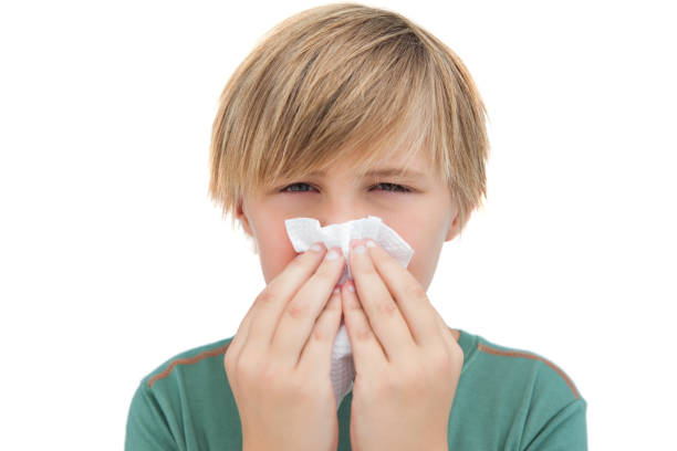 Sick little boy with a handkerchief Sick little boy with a handkerchief on white background human parainfluenza virus stock pictures, royalty-free photos & images