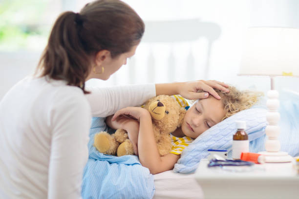 Sick little boy with asthma medicine. Ill child. stock photo