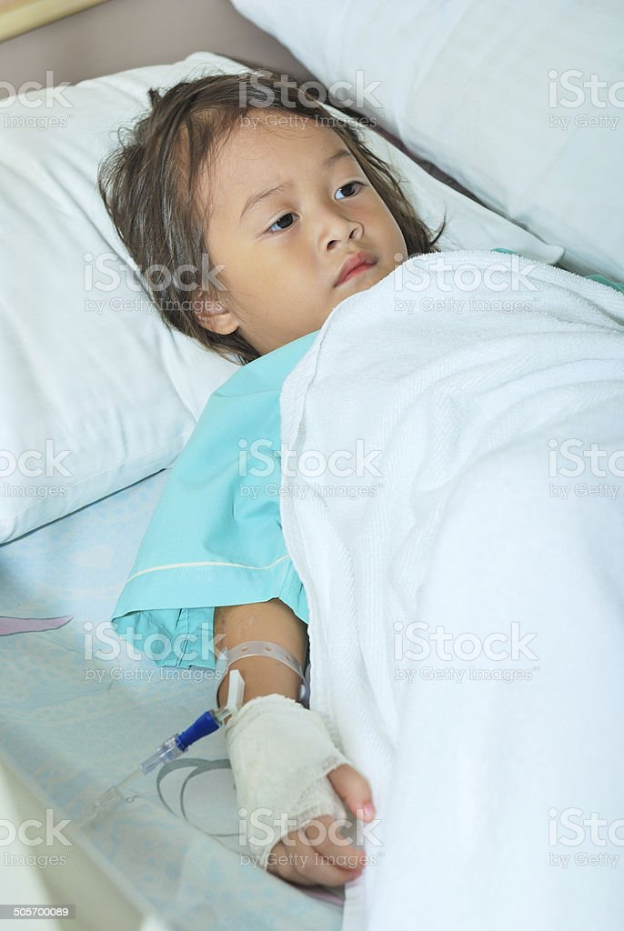 Sick Little Girl In Hospital Bed Stock Photo